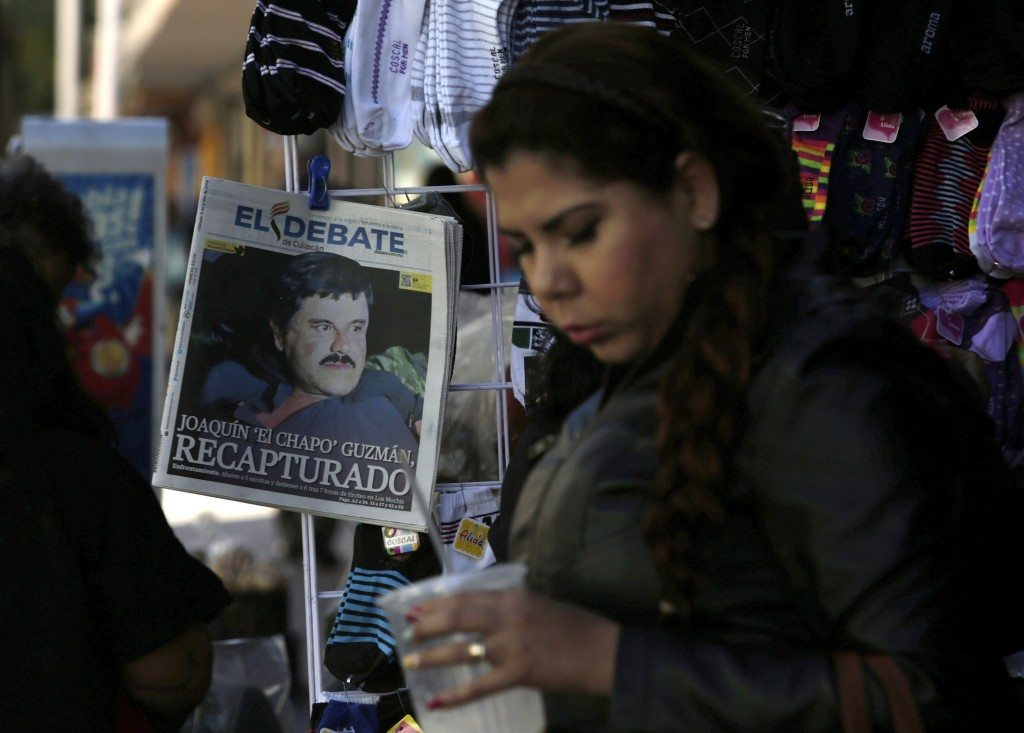 "A woman walks past a newspaper showing a photograph of recaptured drug lord Joaquin ""Chapo"" Guzman on its front page in Culiacan, Mexico, January 9, 2016. REUTERS/Daniel Becerril"
