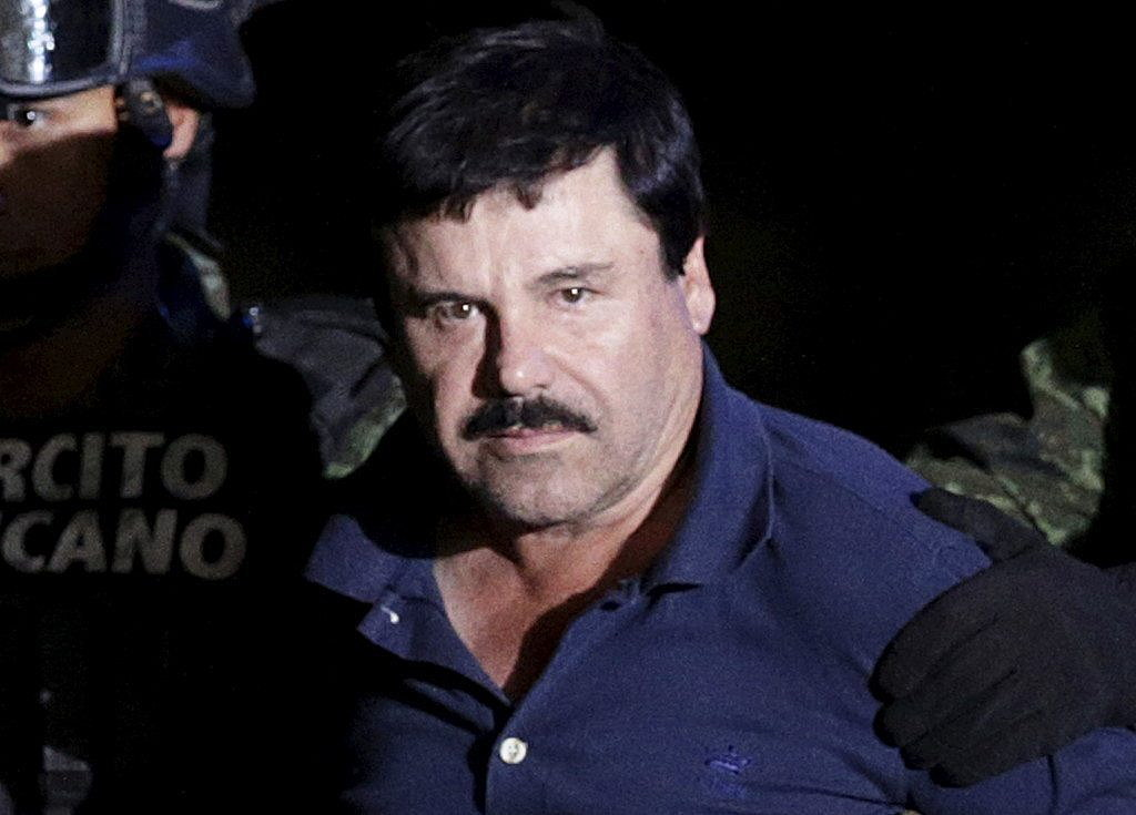 """Recaptured drug lord Joaquin """"El Chapo"""" Guzman is escorted by soldiers at the hangar belonging to the office of the Attorney General in Mexico City, Mexico January 8, 2016. Picture taken January 8, 2016. REUTERS/Henry Romero"""