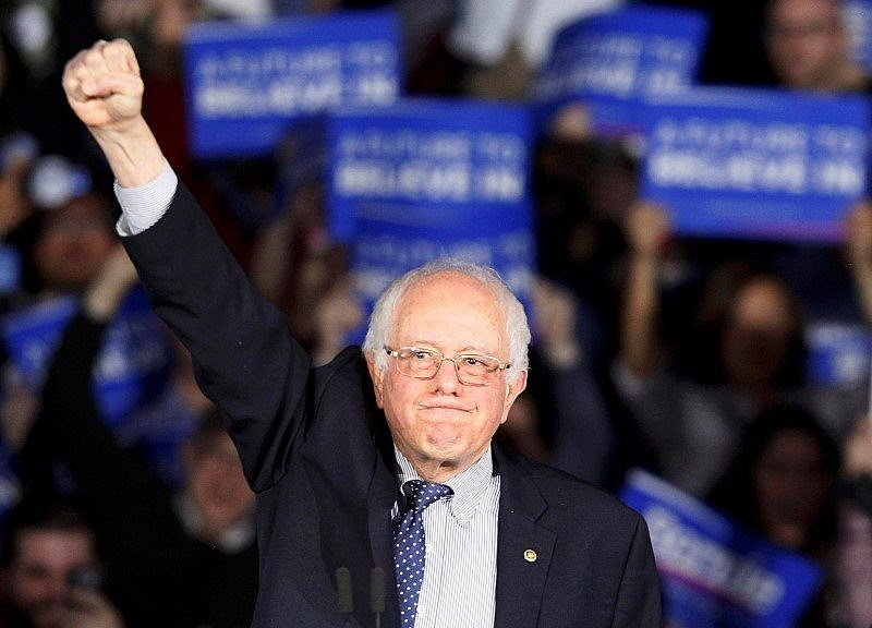 Bernie Sanders raises a fist as he speaks at his caucus night rally Des Moines. REUTERS/Rick Wilking