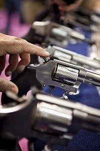 Smith & Wesson revolvers are displayed at the Safari Club International Convention in Reno, Nevada, in this January 29, 2011 file photo. REUTERS/Max Whittaker/Files