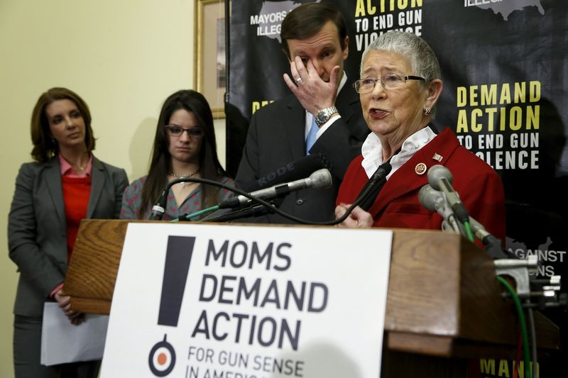 Then-U.S. Representative Carolyn McCarthy (D-NY) (R) speaks at a news conference held by the groups Mayors Against Illegal Guns and Moms Demand Action for Gun Sense in America, on Capitol Hill in Washington, in this February 12, 2014 file photo.   REUTERS/Jonathan Ernst/Files