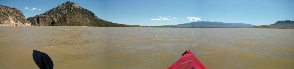 Paddling the muddy waters of Buffalo Bill Reservoir west of Cody, Wyoming. (Photo by Martin Kidston)