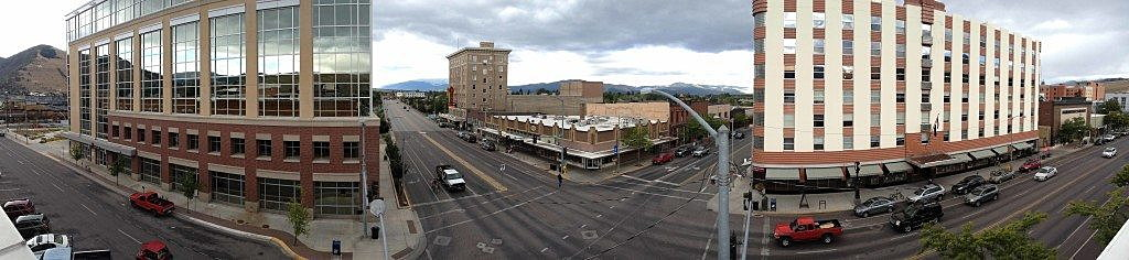 Traffic picks up on the corner of Front Street and Higgins Avenue in downtown Missoula, as seen from the roof of the Missoula Mercantile. (Photo by Martin Kidston)