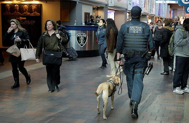 A police officer with a dog patrol in Union Station in Washington March 22, 2016. REUTERS/Joshua Roberts