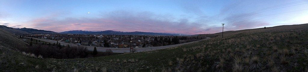 The sun rises and the moon sets over the Missoula Valley on Eastern morning. (Photo by Martin Kidston)