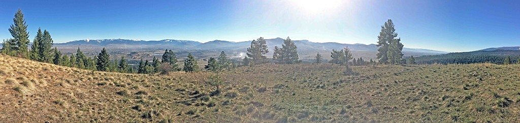 The Missoula Valley stretches from north (left frame) to south (right frame) on a spring morning as seen from Blue Mountain. (Photo by Martin Kidston)
