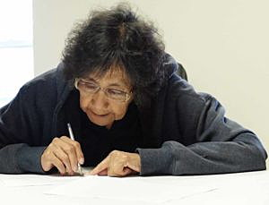 Crow Indian Irma Bird Hat looks over a will she wrote as part of a project helping Native Americans decide on property inheritance in Pryor, Montana, U.S. on May 26, 2016. REUTERS/Ellen Wulfhorst