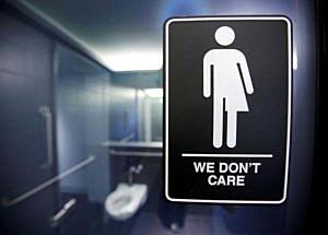 A sign protesting a recent North Carolina law restricting transgender bathroom access adorns the bathroom stalls at the 21C Museum Hotel in Durham, North Carolina May 3, 2016. REUTERS/Jonathan Drake