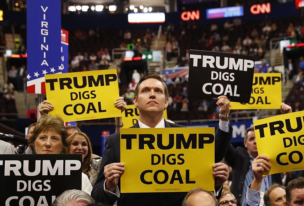 Delegates from West Virginia hold signs supporting coal on the second day of the Republican National Convention in Cleveland, Ohio, U.S. July 19, 2016. REUTERS/Aaron P. Bernstein/File Photo
