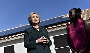 U.S. Democratic presidential candidate Hillary Clinton (L) meets with homeowner Vicki Early to discuss her solar panels in Las Vegas, Nevada February 19, 2016. REUTERS/David Becker/File Photo