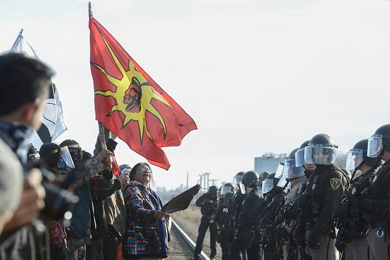 Protesters have a stand off with police during a demonstration against the Dakota Access pipeline near the Standing Rock Indian Reservation in Mandan, North Dakota, November 15, 2016. REUTERS/Stephanie Keith