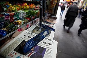 The cover of the Wall Street Journal newspaper is seen with other papers at a news stand in New York U.S., November 9, 2016. REUTERS/Shannon Stapleton