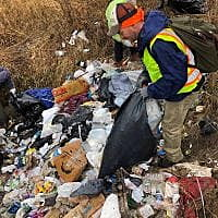 Volunteers clean Reserve Street homeless camp; residents allowed to keep shelters